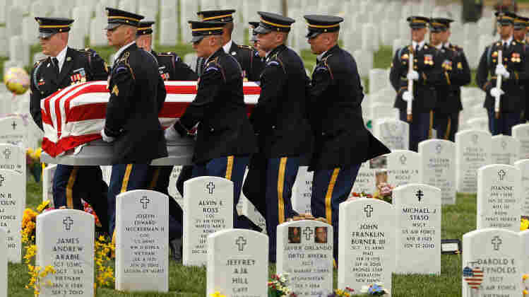 "April 20:  Soldiers from the U.S. Army 3rd Infantry Regiment, also called ""The Old Guard,"" carry U.S. Army Corporal Justin Ross' flag-draped casket during his burial ceremony at Arlington National Cemetery. Ross, 22, of Green Bay, Wis., died March 26 in Helmand province, Afghanistan."
