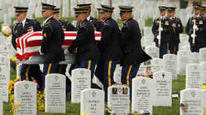 "April 20:  Soldiers from the U.S. Army 3rd Infantry Regiment, also called ""The Old Guard,"" carry U.S. Army Corporal Justin Ross' flag-draped casket during his burial ceremony at Arlington National Cemetery. Ross,"