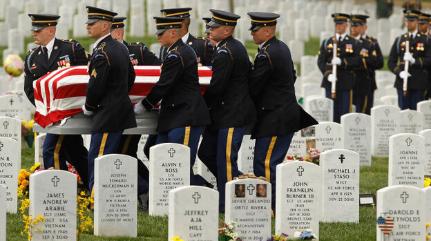 """April 20:  Soldiers from the U.S. Army 3rd Infantry Regiment, also called """"The Old Guard,"""" carry U.S. Army Corporal Justin Ross' flag-draped casket during his burial ceremony at Arlington National Cemetery. Ross, 22, of Green Bay, Wis., died March 26 in Helmand province, Afgha"""