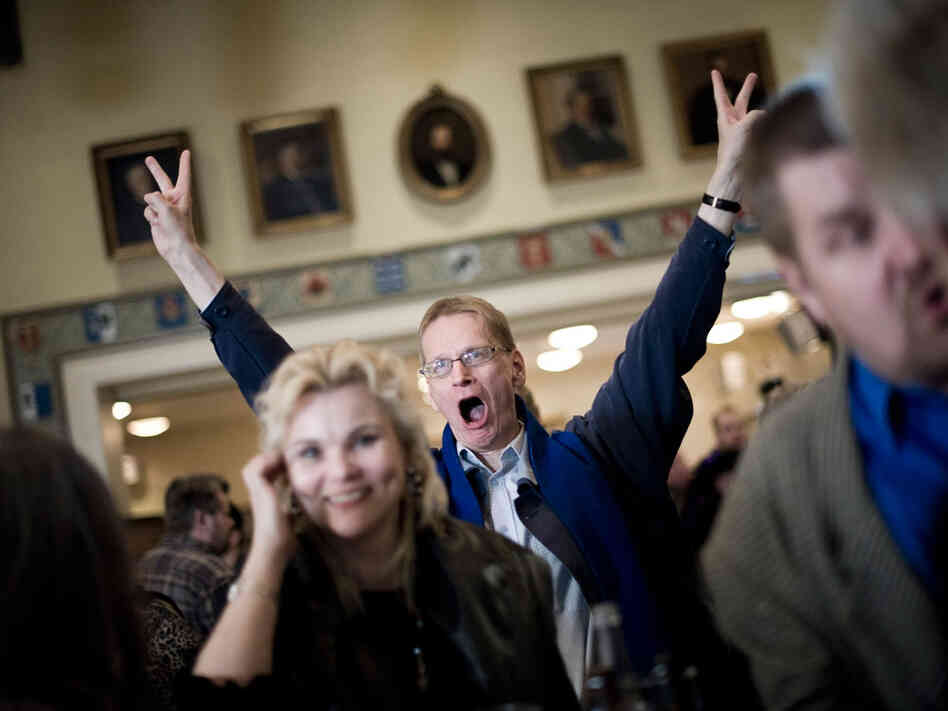 A supporter of Finland's nationalist party, True Finns, celebrates at the election headquarters after the parliamentary elections in Helsinki on April 17. True Finns blew away even the most optimistic predictions to suddenly become a major political force.