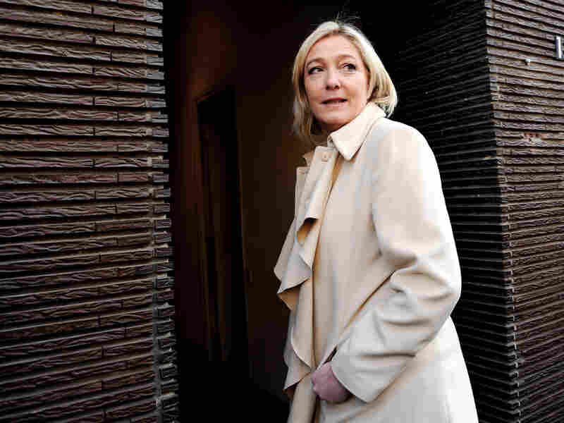 Head of the French Front National Party Marine Le Pen arrives at her party's office after casting a ballot in Henin-Beaumont, France, on March 27, during the second round of the local elections.