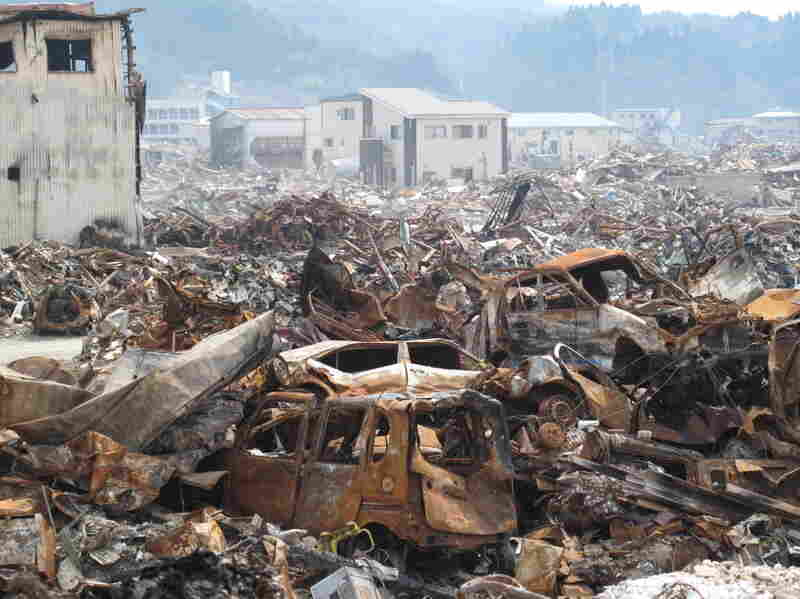In Kesennuma, garbage covers much of the city, particularly in the harbor. Some baseball fields and parks nearby have been converted into areas where cranes can sort through the debris.