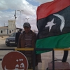 The flag of Libyan rebels hangs at this captured border post in Dhibat. Less than a week ago, the desert post was controlled by Gadhafi's  forces.