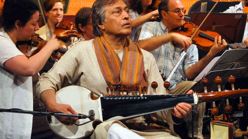 Amjad Ali Khan performs his concerto Samaagam with the Scottish Chamber Orchestra in Mumbai.