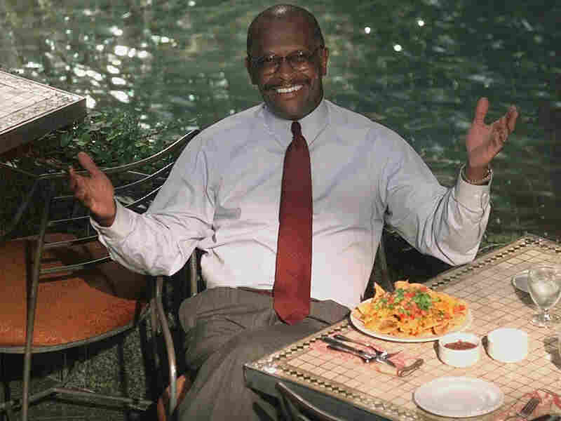 Cain, then-president of the National Restaurant Association, poses during an interview in Chicago in 1998.