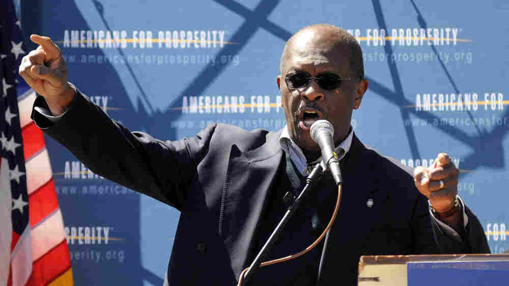 Herman Cain speaks at a Tea Party Tax Day rally this April outside the Statehouse in Concord, N.H. The former Atlanta talk show host and businessman is testing a possible presidential run.