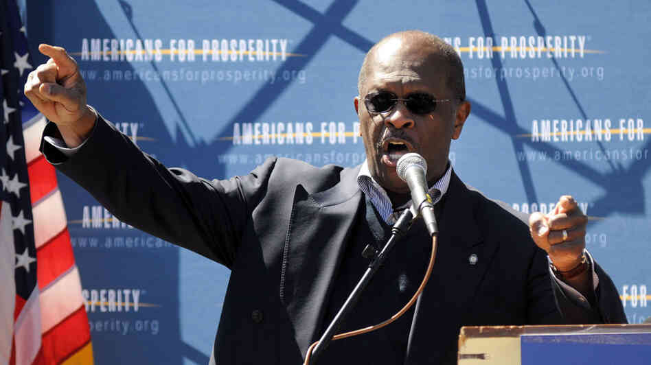 Herman Cain speaks at a Tea Party Tax Day rally this April out