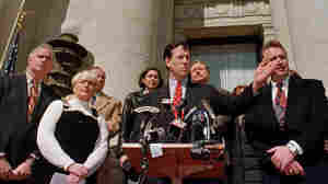 "Delaware County District Attorney Patrick Meehan (from left) and Gail Willard (mother of slain athlete Aimee Willard) accompany Sen. Rick Santorum as he introduces ""Aimee's Law"" along with Republican Arizona Rep. Matt Salmon at the county courthouse in Media, Pa., in 1999. The bill encourages states to keep murderers and sexual predators behind bars."