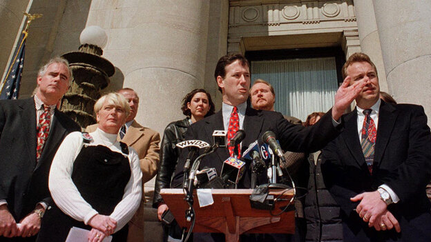 """Delaware County District Attorney Patrick Meehan (from left) and Gail Willard (mother of slain athlete Aimee Willard) accompany Sen. Rick Santorum as he introduces """"Aimee's Law"""" along with Republican Arizona Rep. Matt Salmon at the county courthouse in Media, Pa., in 1999. The bill encourages states to keep murderers and sexual predators behind bars."""