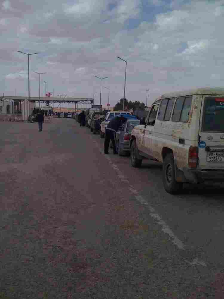 Cars are lined up at a border crossing in Dhibat, Libya, waiting to cross into Tunisia. Libyan rebels took the desert post from Ghadafi forces last week.