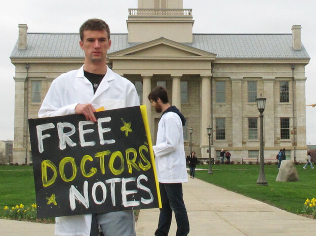 University of Iowa junior and College Republican Ryan Helgerson, dressed as a doctor and handed out f