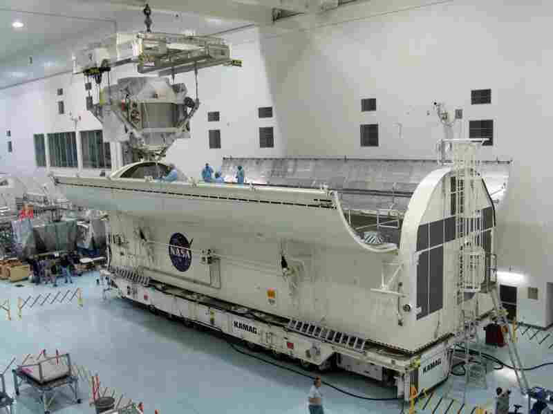 The Alpha Magnetic Spectrometer is loaded into the vehicle that would take it to the space shuttle launchpad on March 15. The $2 billion cosmic ray detector will be carried to the International Space Station on Endeavour's final flight.