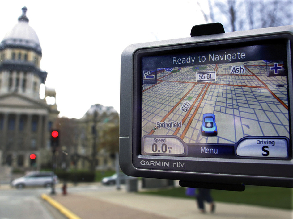 TomTom manufactures GPS navigation devices like this one from its competitor Garmin. (Seth Perlman/AP)