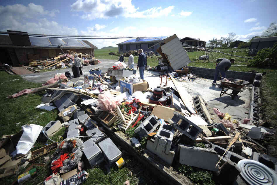Residents clean up storm damage in Bethel, Va., on Friday.