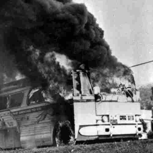 A Freedom Rider bus went up in flames in May 1961 when a firebomb was tossed through a window near Anniston, Ala. Passengers escaped without serious injury.