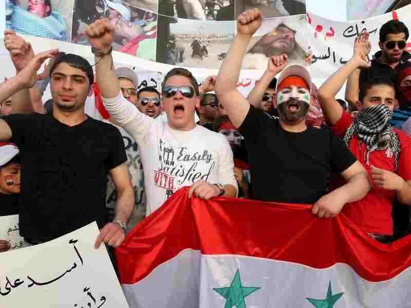 Syrian nationals living in Jordan shout slogans against Syrian President Bashar al-Assad during a demonstration in front of the Syrian embassy in Amman on April 17, 2011.