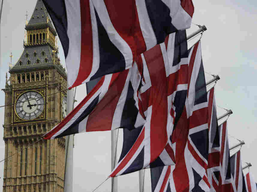 British Union Jack flags fluttered in the wind next to Big Ben, in London, on Thursday (April 28, 2011).