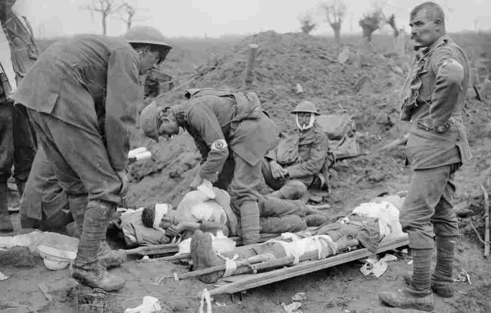 Soldiers care for the wounded on the first day of the Battle of Passchendaele on  July 31, 1917. Fought in West Flanders, Belgium, Passchendaele was one of the war's most costly clashes.
