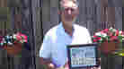 Alfredo Navas holds a photo collage of his mother at his Miami home. The Navas family sued Isabel Lopez's company, saying that negligence led to Aurora Navas's death. The suit was settled for an undisclosed amount.