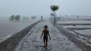 Villagers along the southern coast of Bangladesh not only have to cope with some of the world's heaviest rainfall; they also live in cyclone-battered communities, on mushy ground just a few feet above a rising sea.