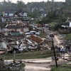 Residents survey the destruction after a tornado hit Pratt City, Ala. just north of downtown Birmingham, Ala. on Wednesday, April 27, 2011.