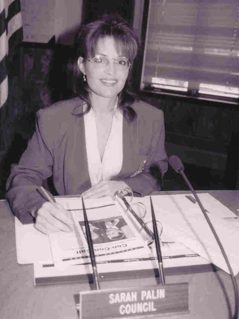 Sarah Palin sits at her Wasilla City Council desk in this undated photograph.