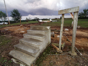 Concrete steps lead to the footprint of a mobile home scraped from the earth by a tornado that ripped across Preston,  Miss., on Wednesday.