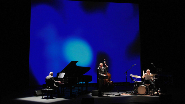 The Bad Plus plays its take on The Rite of Spring at Duke Performances, backed by a multimedia backdrop created by architect Cristina Guadalupe and filmmaker Noah Hutton. (Courtesy of Darryl Pitt)