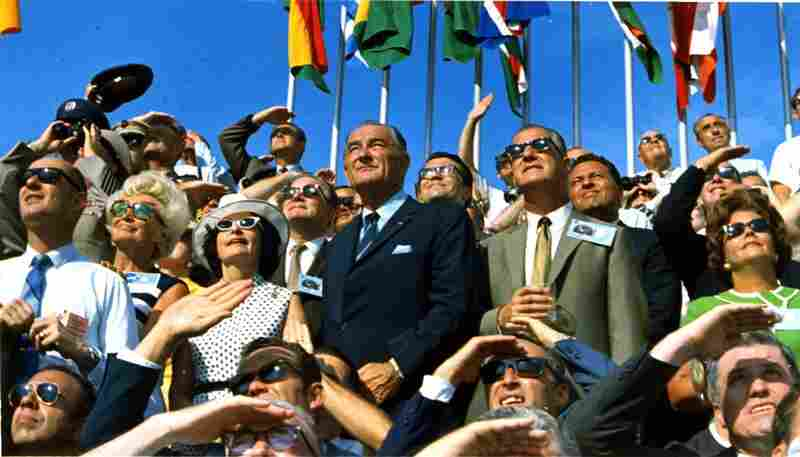 Former President Lyndon B. Johnson (center left) and Vice President Spiro Agnew watch Apollo 11 lift off toward the moon from Kennedy Space Center on July 16, 1969.