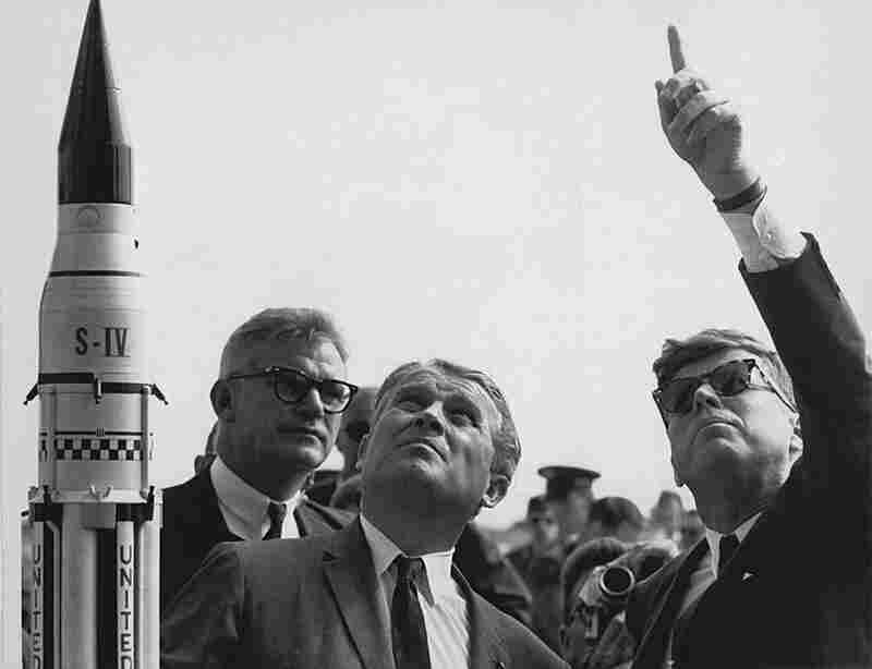 President John F. Kennedy gets a lesson on the Saturn launch system from Wernher von Braun (center), a German rocket scientist who championed America's space exploration program, during a visit to Cape Canaveral on Nov. 16, 1963.