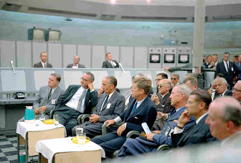 President Kennedy (center) receives a briefing from Maj. Rocco Petrone (not pictured) while on a tour of Cape Canaveral in September 1962.