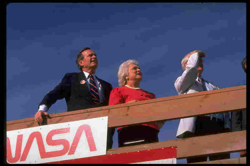 Vice President George H.W. Bush and Barbara Bush await the landing of the space shuttle Discovery at Edwards Air Force Base in California in October 1988.