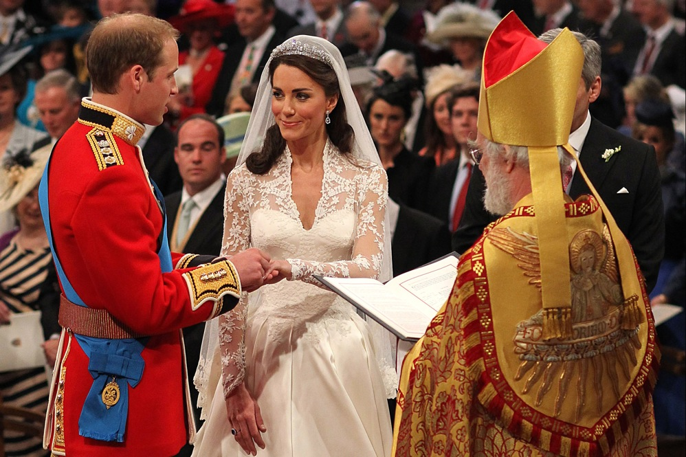 Prince William exchanges rings with his bride in front of the Archbishop of Canterbury, Rowan Williams.