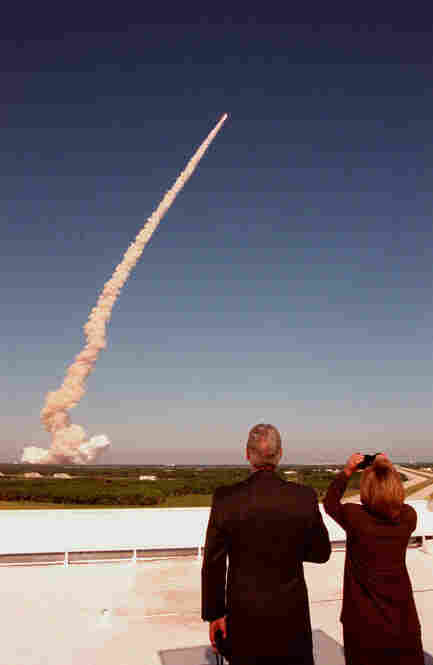 From the roof of the Launch Control Center, President Bill Clinton and Hillary Clinton watch the launch of space shuttle Discovery on Oct. 29, 1998. Astronaut and Sen. John Glenn was on the flight, his second to space.