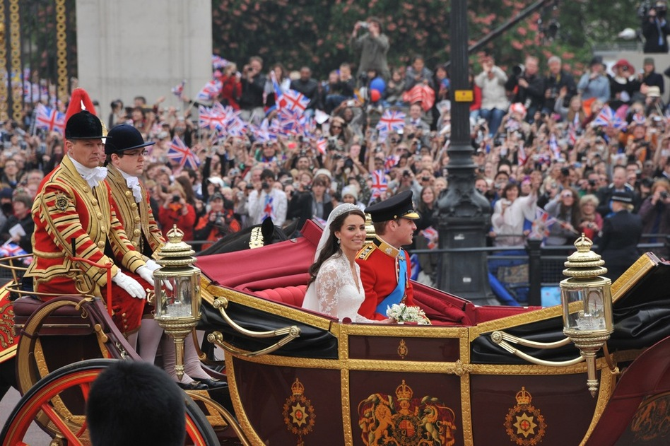 The newlyweds travel in the 1902 State Landau carriage to Buckingham Palace.  (AFP/Getty Images)