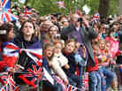 Well wishers with flags and cameras after the Royal Wedding of Prince William to Catherine Middleton at Westminster Abbey.