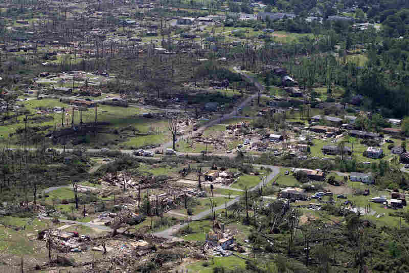 An aerial view shows the tornado damage spread over a half-mile wide path in Pleasant Grove, Ala., Thursday.