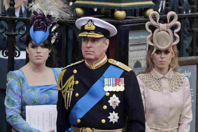 Britain's Prince Andrew (center) and his daughters,  Princess Eugenie (left) and  Princess Beatrice, leave Westminster Abbey after the royal wedding.