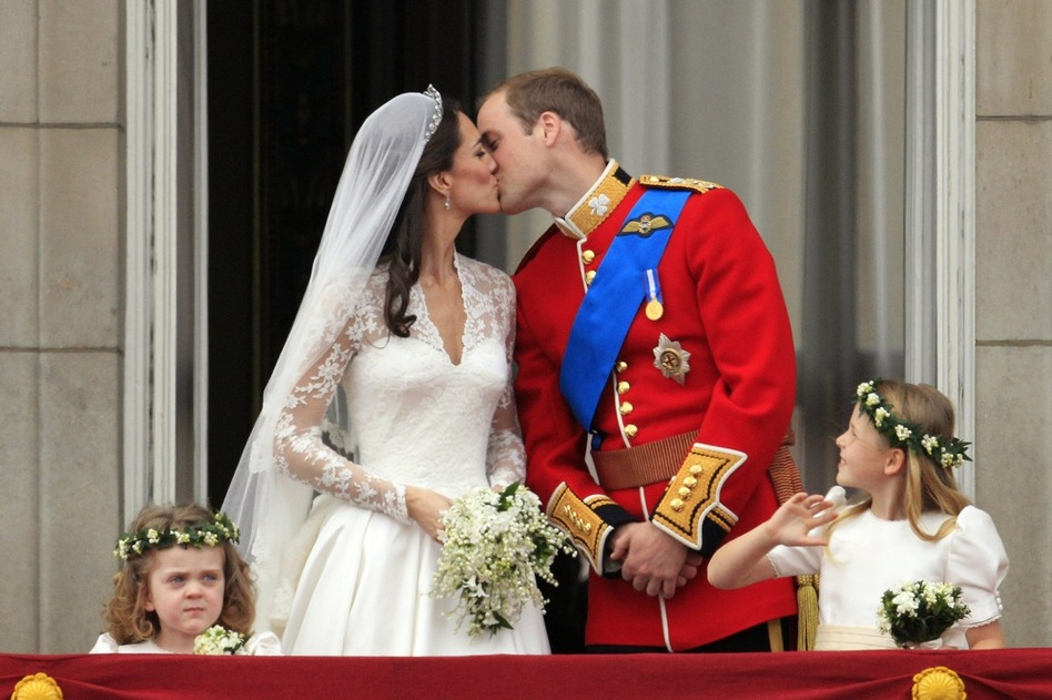 Prince William and Kate, Duchess of Cambridge, kiss on the balcony of Buckingham Palace after the royal wedding in London on Friday.  (AP)