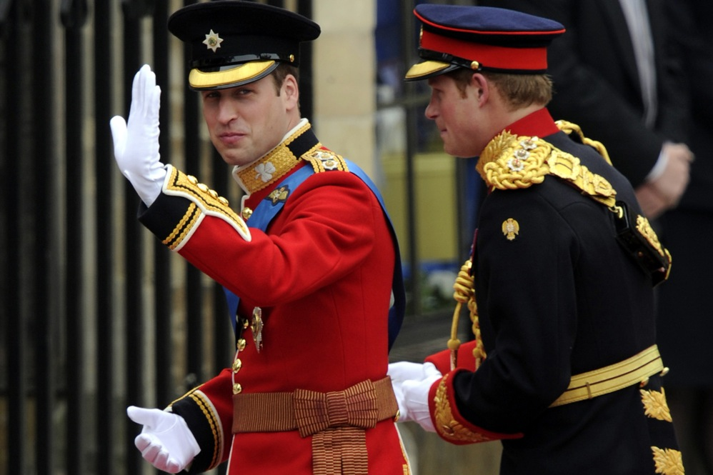 Britain's Prince William (left) waves as he arrives with his brother, Prince Harry, at Westminster Abbey.