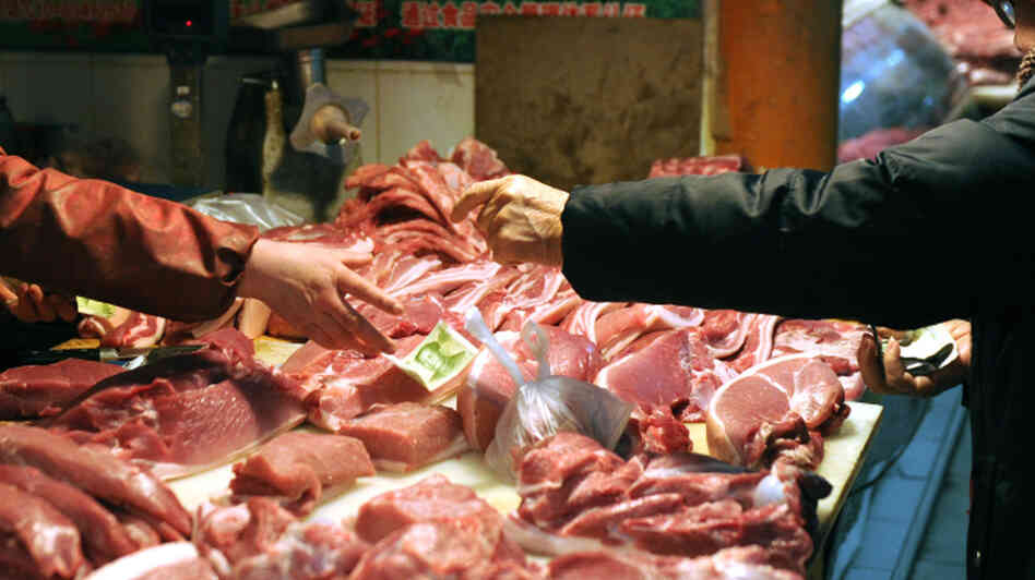 Pork is sold in a market in Beijing.