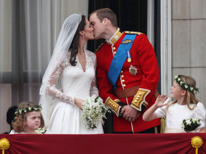 Their Royal Highnesses Prince William, Duke of Cambridge and Catherine, Duchess of Cambridge kiss on the balcony at Buckingham Palace after their wedding.