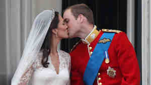Their Royal Highnesses Prince William, Duke of Cambridge and Catherine, Duchess of Cambridge kiss on the balcony at Buckingham Palace