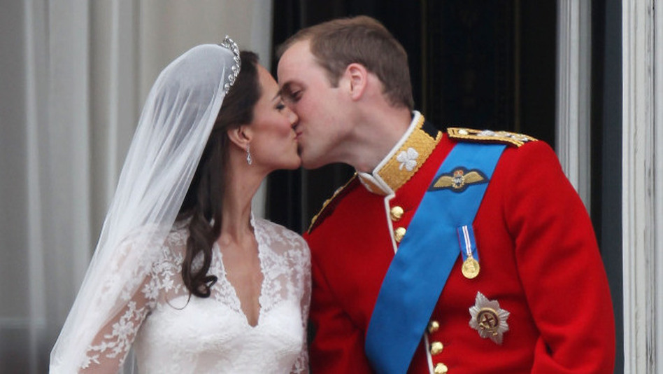Their Royal Highnesses Prince William, Duke of Cambridge and Catherine, Duchess of Cambridge kiss on the balcony at Buckingham Palace after their wedding. (Peter Macdiarmid/Getty Images)