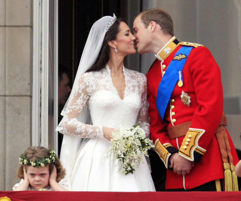 While millions of onlookers enjoyed the newlyweds' kiss at Buckingham Palace, a certain someone (left) seemed to be not pleased. (AP Photo/Matt Dunham)