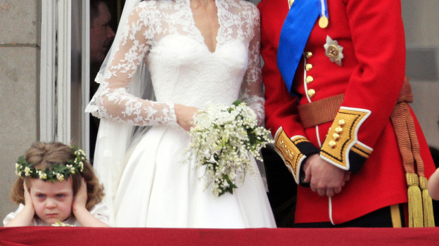 While millions of onlookers enjoyed the newlyweds' kiss at Buckingham Palace, a certain someone (left) seemed to be not pleased. (AP Photo/Matt Dunham) (AP)