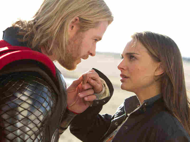 Jane Foster (Natalie Portman, right), an astrophysicist who discovers Thor in the desert, guides the hero through life among humankind.