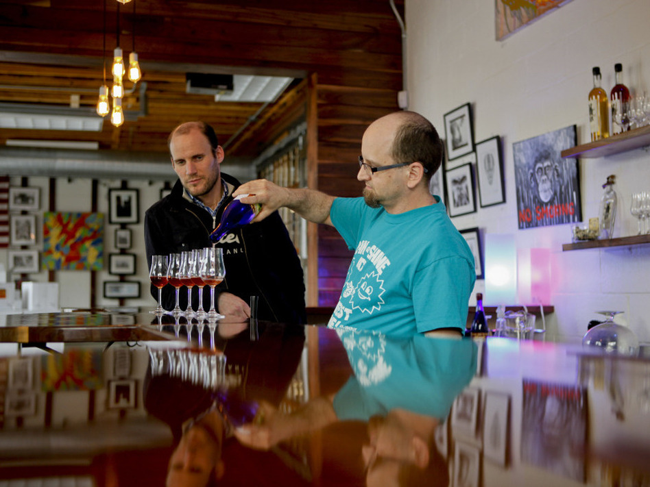 "Woody  Drake, mead master at Brothers Drake, pours samples as  general manager Oren Benary (left) observes. It's a common misconception that mead is an exclusively sweet drink. ""Mead goes everywhere from dry to sweet and everything in between,"" Drake says. ( )"