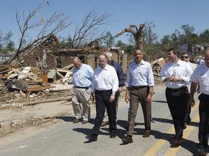 President Obama, flanked by Alabama Gov. Robert Bentley and Tuscaloosa, Ala., Mayor Walter Maddox, tours tornado damage in Tuscaloosa on Friday.