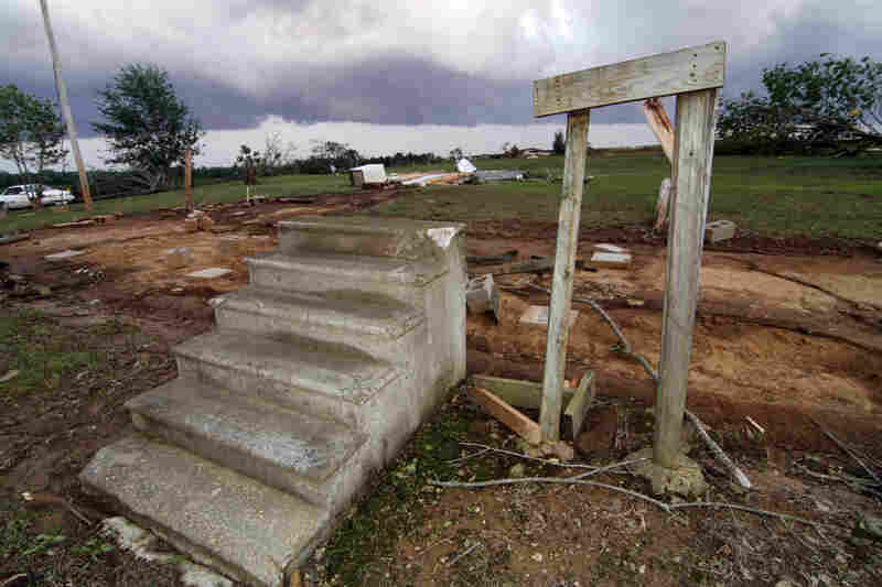 Concrete steps lead to the footprint of a mobile home that was ripped away by a tornado in Preston, Miss.
